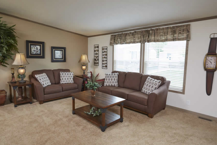 Living room with large windows, and beige carpet in Berkshire model