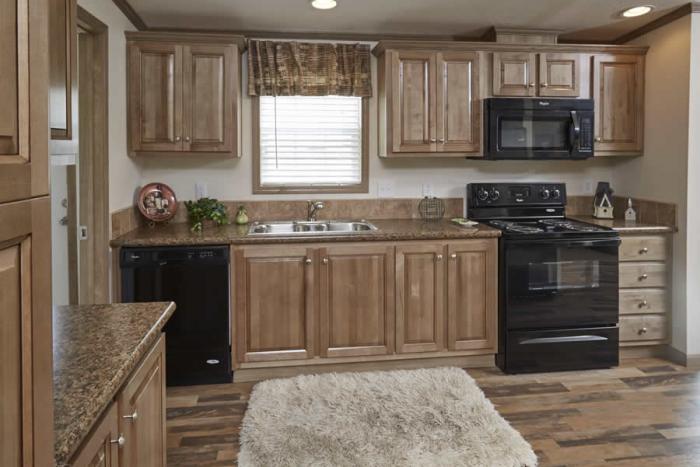 kitchen in Berkshire model. Oak cabinets and wood floors