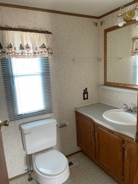 bathroom with window of available pre-owned home at 3325 Pierce Ave, #211