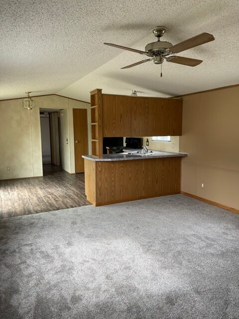 living room and kitchen of available pre-owned home at 3325 Pierce Ave, #211