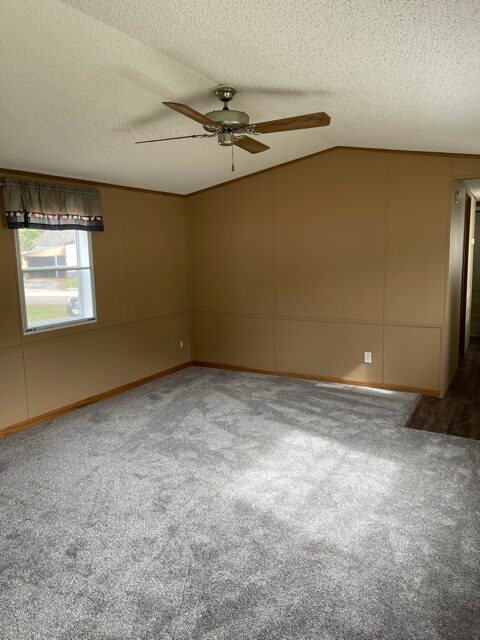 living room with ceiling fan of available pre-owned home at 3325 Pierce Ave, #211