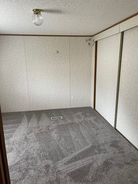 master bedroom with closet of available pre-owned home at 3325 Pierce Ave, #211